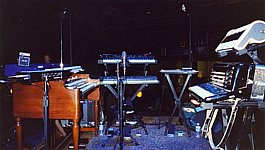 Rob's S&G rig: From Left: Moog Theremin Etherwave, Kurzweil 2600 atop Hammond B3, Prophet VS atop Alesis Andromeda, Electric autoharp, Hohner Claviola atop Accordian""